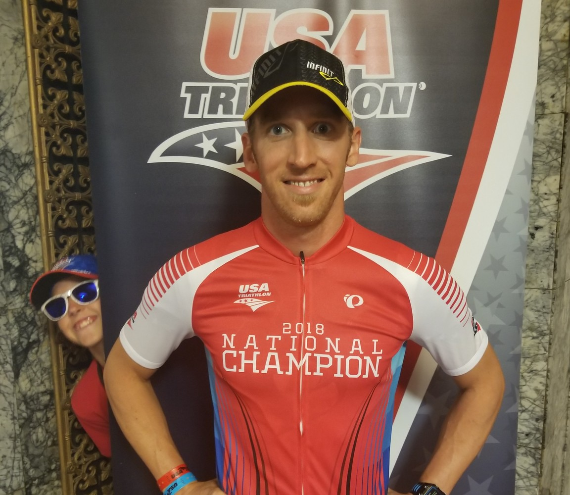 Hanging out getting a picture with one of my two National Champion jerseys from Duathlon Nationals not knowing my youngest son photo bombing me.... :)